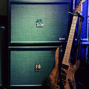 2 BOSS Waza Craft 150 watt heads, 1 Waza 4x12 speaker cabinet, and 2 Waza 2x12 speaker cabs. + The Himmelator Guitar